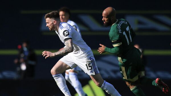 Leeds United's Northern Irish midfielder Stuart Dallas (L) runs with the ball during the English Premier League football match between Leeds United and Sheffield United at Elland Road in Leeds, northern England on April 3, 2021. (Photo by Lindsey Parnaby / POOL / AFP) / RESTRICTED TO EDITORIAL USE. No use with unauthorized audio, video, data, fixture lists, club/league logos or 'live' services. Online in-match use limited to 120 images. An additional 40 images may be used in extra time. No video emulation. Social media in-match use limited to 120 images. An additional 40 images may be used in extra time. No use in betting publications, games or single club/league/player publications. /