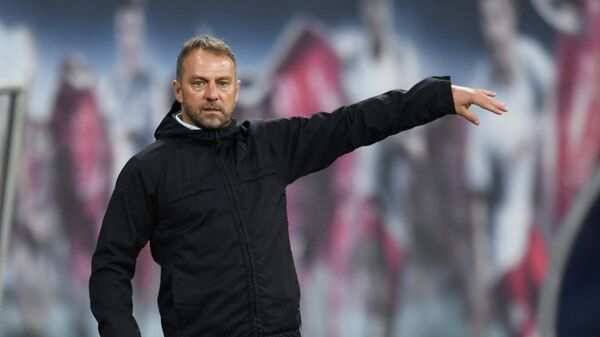 Bayern Munich's German head coach Hans-Dieter Flick reacts from the sidelines during the German first divison Bundesliga football match between RB Leipzig and FC Bayern Munich in Leipzig, eastern Germany, on April 3, 2021. (Photo by ANNEGRET HILSE / POOL / AFP) / DFL REGULATIONS PROHIBIT ANY USE OF PHOTOGRAPHS AS IMAGE SEQUENCES AND/OR QUASI-VIDEO