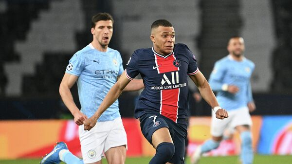 Paris Saint-Germain's French forward Kylian Mbappe runs after the ball during the UEFA Champions League first leg semi-final football match between Paris Saint-Germain (PSG) and Manchester City at the Parc des Princes stadium in Paris on April 28, 2021. (Photo by Anne-Christine POUJOULAT / AFP)