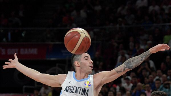 Argentina's Luca Vildoza goes for the ball during the Basketball World Cup semi-final game between Argentina and France in Beijing on September 13, 2019. (Photo by NOEL CELIS / AFP)