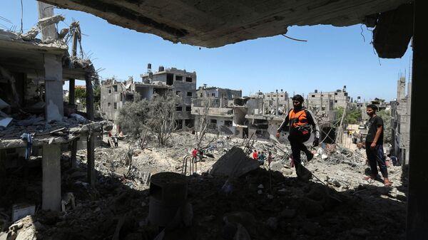 Разрушенные в результате израильских авиационных и артиллерийских ударов дома в северной части сектора Газа
