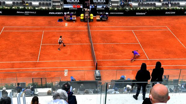Spain's Rafael Nadal (R) returns the ball to Germany's Alexander Zverev during their tennis match at the Men's Italian Open at Foro Italico on May 14, 2021 in Rome, Italy. (Photo by Andreas SOLARO / AFP)