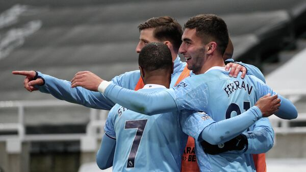 Manchester City's Spanish midfielder Ferran Torres (R) celebrates scoring his team's fourth goal, his third, during the English Premier League football match between Newcastle United and Manchester City at St James' Park in Newcastle-upon-Tyne, north east England on May 14, 2021. (Photo by SCOTT HEPPELL / POOL / AFP) / RESTRICTED TO EDITORIAL USE. No use with unauthorized audio, video, data, fixture lists, club/league logos or 'live' services. Online in-match use limited to 120 images. An additional 40 images may be used in extra time. No video emulation. Social media in-match use limited to 120 images. An additional 40 images may be used in extra time. No use in betting publications, games or single club/league/player publications. /