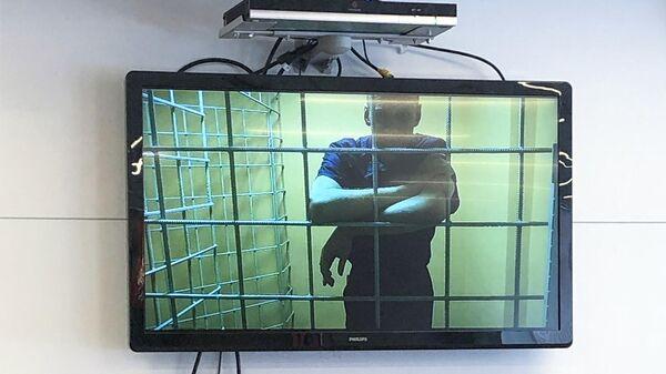 Алексей Навальный по видеосвязи принимает участие в заседании Преображенского районного суда города Москвы, где рассматривается иск к СИЗО -1 Матросская Тишина о признании его склонным к побегу
