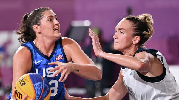 USA's Stefanie Dolson (L) fights for the ball with Russia's Anastasiia Logunova during the women's first round 3x3 basketball match between Russia and US at the Aomi Urban Sports Park in Tokyo, on July 25, 2021 during the Tokyo 2020 Olympic Games. (Photo by Andrej ISAKOVIC / AFP)