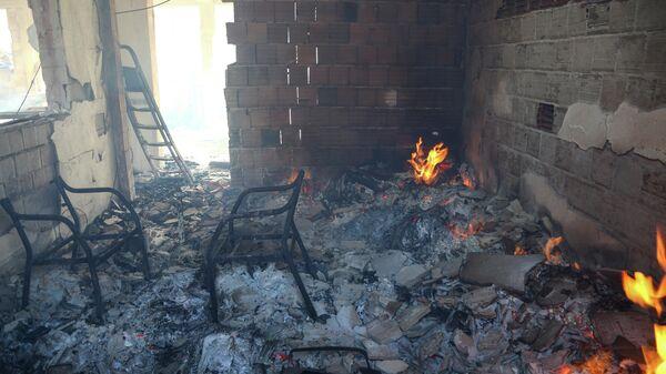 Сгоревший дом в результате лесного пожара в Анталье, Турция