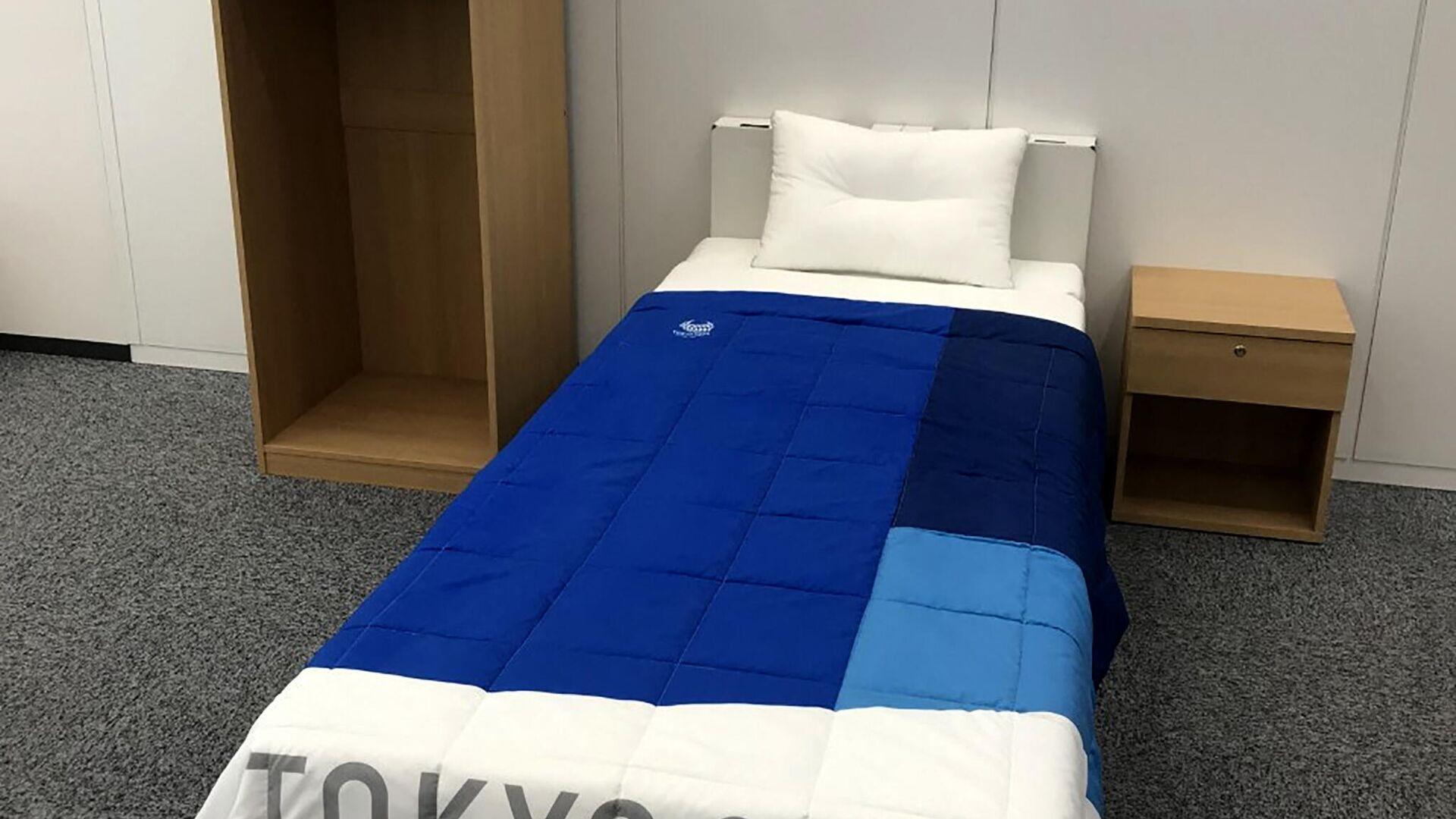 Картонные кровати для спортсменов в Олимпийской деревне на Играх в Токио - РИА Новости, 1920, 01.08.2021