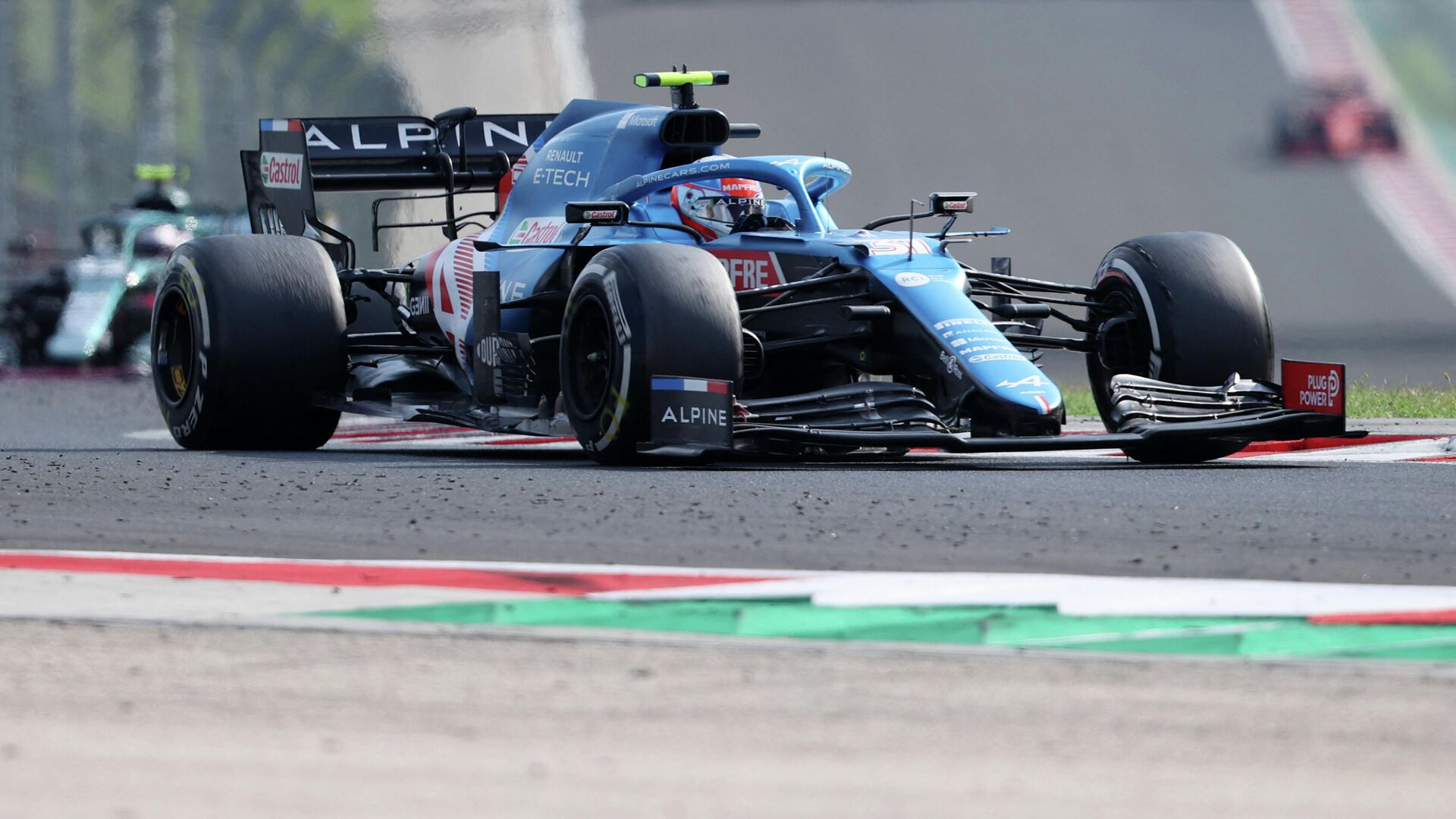 Alpine's French driver Esteban Ocon competes to win the Formula One Hungarian Grand Prix at the Hungaroring race track in Mogyorod near Budapest on August 1, 2021. (Photo by FERENC ISZA / AFP) - РИА Новости, 1920, 01.08.2021