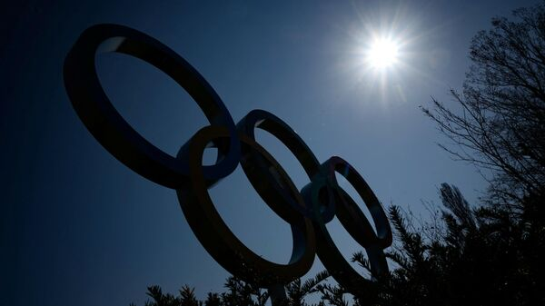 The Olympic Rings logo is pictured in front of the headquarters of the International Olympic Committee (IOC) in Lausanne on March 18, 2020, as doubts increase over whether Tokyo can safely host the summer Games amid the spread of the COVID-19. - Olympic chiefs acknowledged on March 18, 2020 there was no ideal solution to staging the Tokyo Olympics amid a backlash from athletes as the deadly coronavirus pandemic swept the globe. The Tokyo Olympics are scheduled to run between July 24 and August 9, 2020. (Photo by Fabrice COFFRINI / AFP)