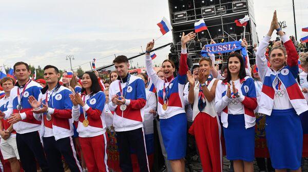 Российские спортсмены, члены сборной России (команда ОКР) на концерте в честь российских спортсменов, выступавших на XXXII летних Олимпийских играх в Токио