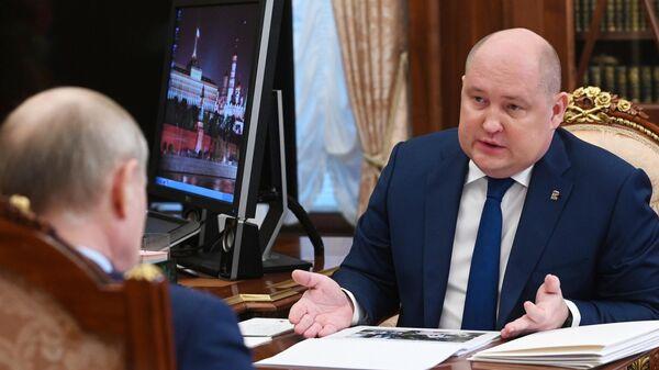 Губернатор Севастополя Михаил Развозжаев во время встречи с президентом РФ Владимиром Путиным
