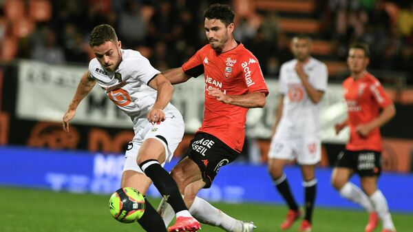 Lorient's French midfielder Thomas Monconduit (R) fights for the ball with Lille's defender Gabriel Johan Gudmundsson during the French L1 football match between FC Lorient and LOSC Lille, at the Moustoir stadium in Lorient, north-western France on September 10, 2021. (Photo by Fred TANNEAU / AFP)