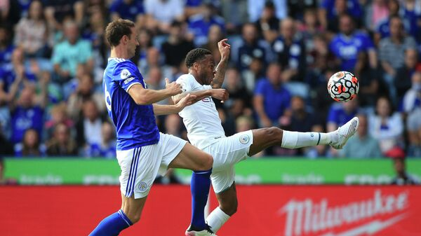 Leicester City's Northern Irish defender Jonny Evans (L) chases Manchester City's English midfielder Raheem Sterling during the English Premier League football match between Leicester City and Manchester City at King Power Stadium in Leicester, central England on September 11, 2021. (Photo by Lindsey Parnaby / AFP) / RESTRICTED TO EDITORIAL USE. No use with unauthorized audio, video, data, fixture lists, club/league logos or 'live' services. Online in-match use limited to 120 images. An additional 40 images may be used in extra time. No video emulation. Social media in-match use limited to 120 images. An additional 40 images may be used in extra time. No use in betting publications, games or single club/league/player publications. /