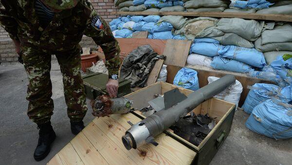 Фрагменты кассетных боеприпасов применяемых Вооруженными силами Украины при обстреле города Горловка Донецкой области. Архивное фото