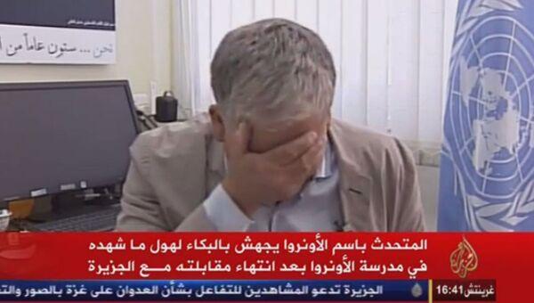 Кадр из видео. Пресс-секретарь Ближневосточного агентства ООН Крис Ганнесс во время интервью арабскому телеканалу Al Jazeera