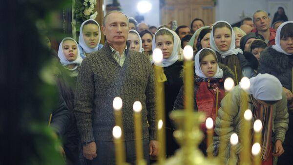 Президент РФ В.Путин посетил Рождественское богослужение