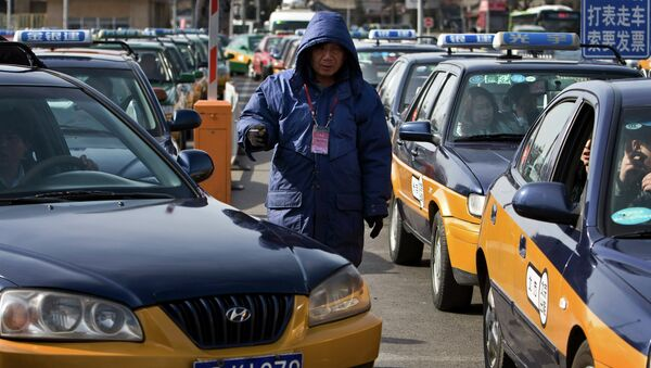 Автомобили такси. Китай. Архивное фото