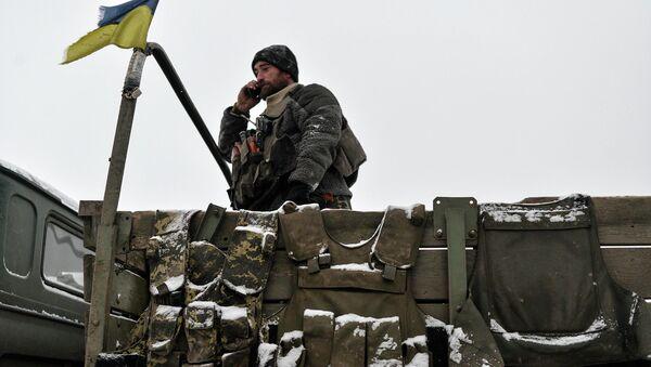 Украинский военный на броне возле города Дебальцево