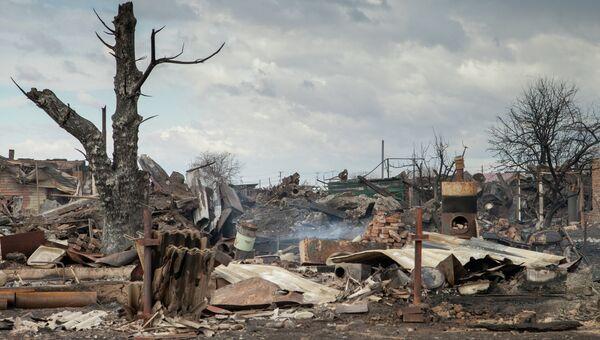Последствия пожара в деревне Новоенисейка Республики Хакасия