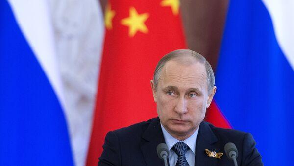 Президент Российской Федерации Владимир Путин на церемонии подписания совместных российско-китайских документов в Кремле