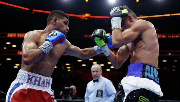 Британец Амир Хан нанес поражение американскому боксеру Крису Алджиери, 29 мая 2015