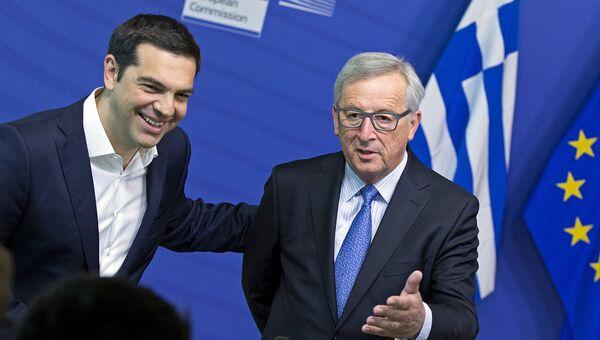 Премьер-министр Греции Алексис Ципрас и президент Европейской комиссии Жан-Клод Юнкер во время встречи в Брюсселе 22 июня 2015 года