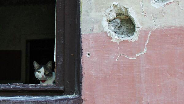 Поврежденный в результате обстрела дом в Горловке. Архивное фото