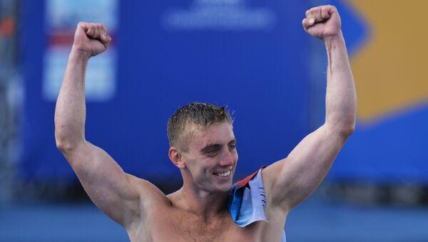 Артем Сильченко в соревнованиях по прыжкам в воду с вышки 27 м на XVI чемпионате мира по водным видам спорта в Казани