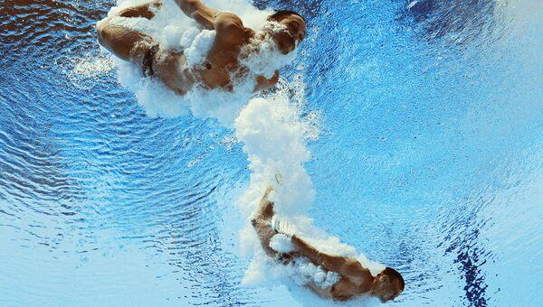 Илья Кваша и Александр Горшковозов (Украина) в соревнованиях предварительного раунда по синхронным прыжкам в воду. Архивное фото