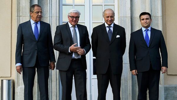 Главы МИД России, Германии, Франции и Украины на встрече в Берлине