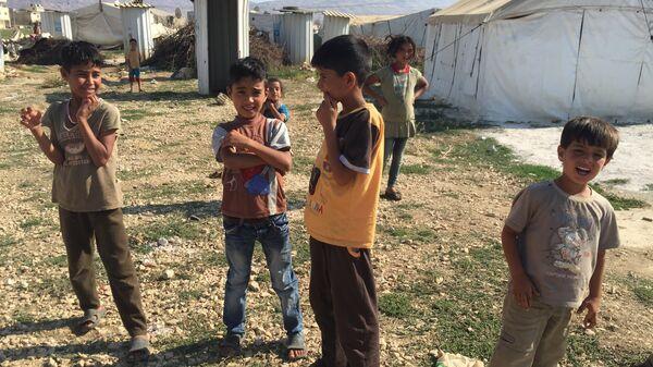 Сирийские дети в лагере беженцев. Архивное фото