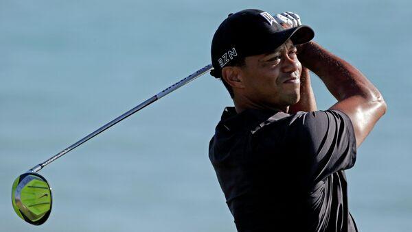 Американский игрок в гольф Тайгер Вудс