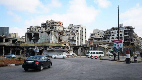 Разрушенные дома в сирийском городе Хомс