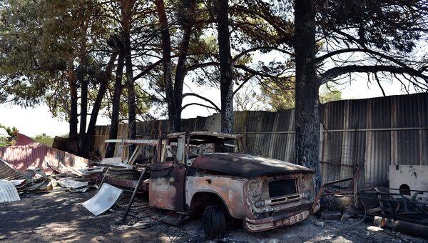 Сгоревший в результате лесных пожаров автомобиль. Австралия, ноябрь 2015