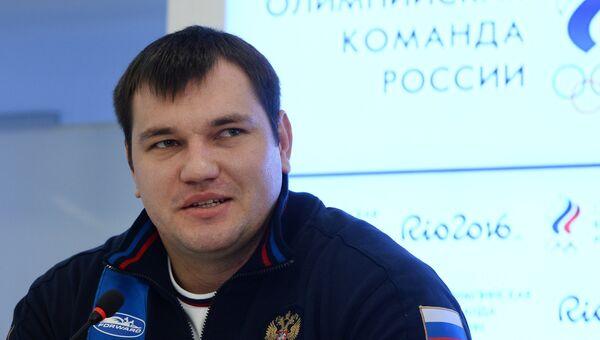 Российские тяжелоатлет Алексей Ловчев. Архивное фото