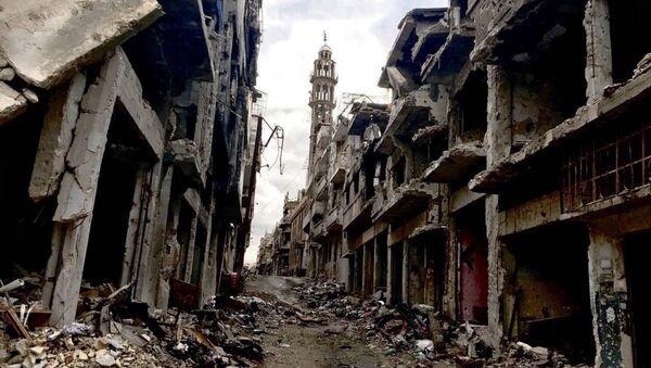 Разрушенные здания в сирийском городе Хомсе. Архивное фото