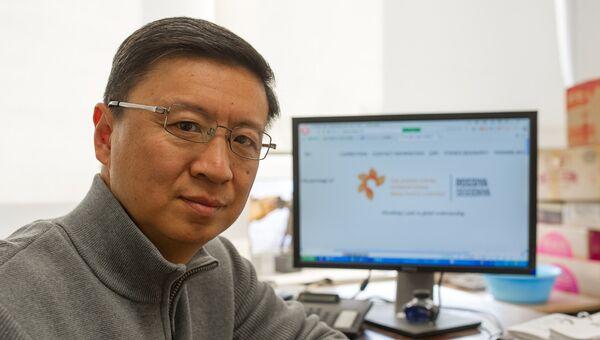 Заместитель директора департамента фотоинформации китайского новостного агентства Синьхуа Чжэн Вэй