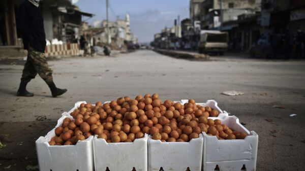 Апельсины на улице в Идлибе, Сирия