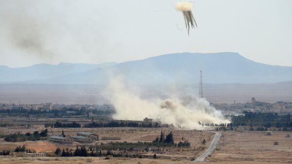 Вид на город Эль-Карьятейн, на который при поддержке артиллерии и вертолетов ВВС Сирии ведет наступление сирийская армия и отряды ополчения