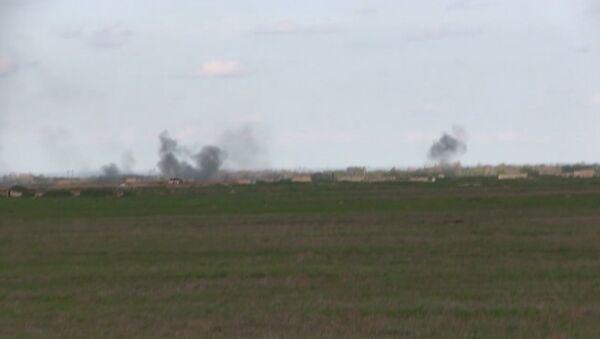 Последствия обстрелов в жилом секторе и на военной базе в Нагорном Карабахе