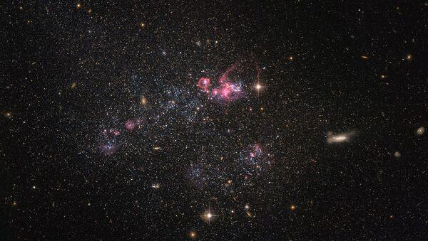 Карликовая галактика, известная как UGC 4459 снятая телескопом Хаббл