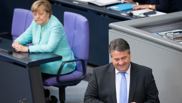410c86c67903 Министр экономики и вице-канцлер Германии Зигмар Габриэль и канцлер Ангела  Меркель. Архивное фото