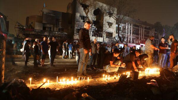 Свечи в память о погибших во время террористического акта в Багдаде. 4 июля 2016