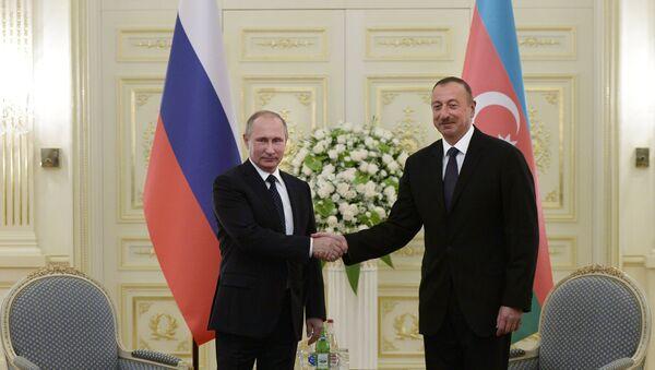 Президент России Владимир Путин и президент Азербайджана Ильхам Алиев. Архивное фото