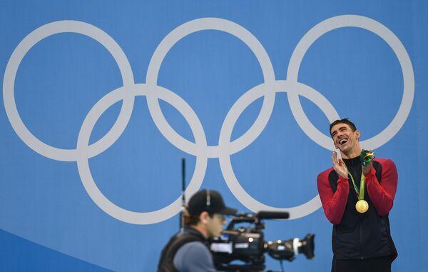 Майкл Фелпс (США), завоевавший золотую медаль на соревнованиях по плаванию на дистанции 200 м баттерфляем среди мужчин на XXXI летних Олимпийских играх