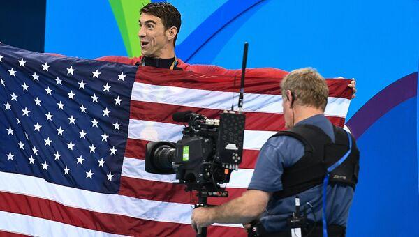 Майкл Фелпс (США), завоевавший золотую медаль на соревнованиях по плаванию в комбинированной эстафете 4х100 м на XXXI летних Олимпийских играх
