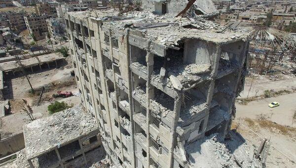 Разрушенное здание в квартале Бани-Зейд на севере Алеппо. Архивное фото