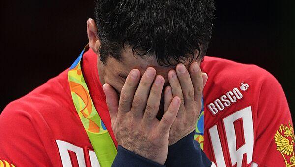 Миша Алоян (Россия), завоевавший серебряную медаль в соревнованиях по боксу на XXXI летних Олимпийских играх