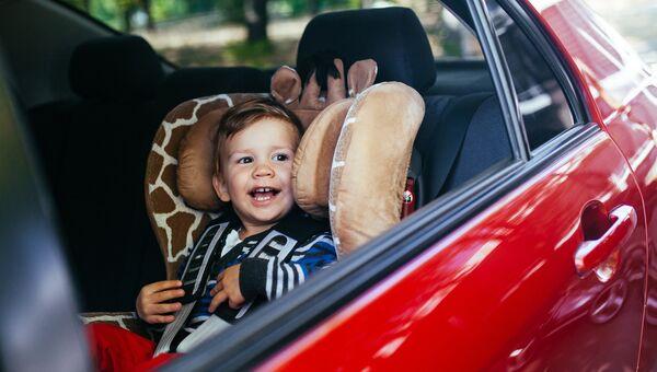 Ребенок в автокресле. Архивное фото