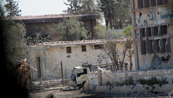 Здание школы ВВС на юге сирийского города Алеппо. Архивное фото